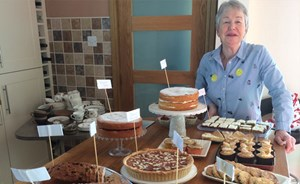 Volunteer with home made cake sale