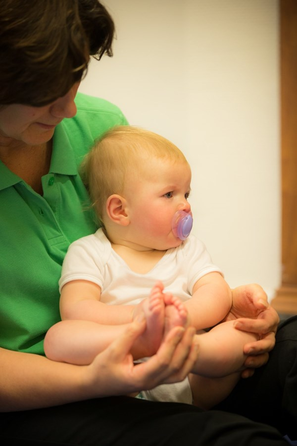 baby being held by a therapist